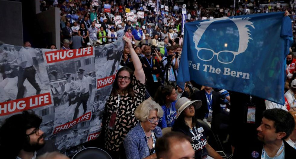 Sanders backers revolt at raucous opening to Democratic convention