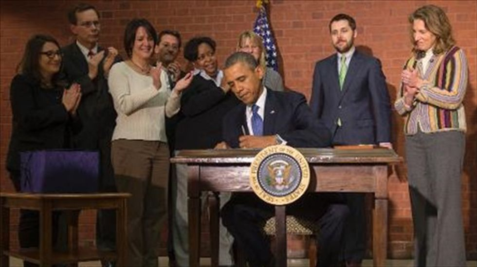 Obama signs bipartisan spending bill into effect