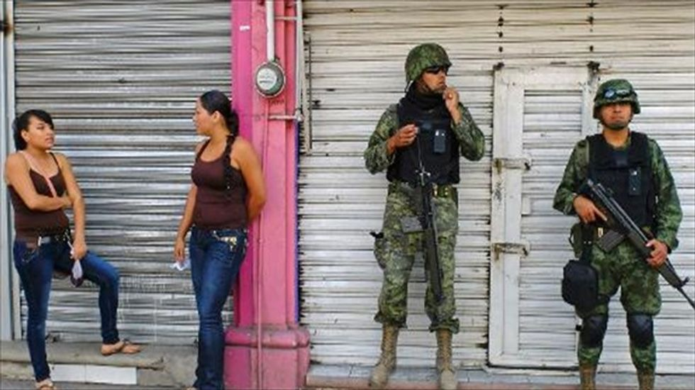 Mexican anti-drug militias return seized land to villagers