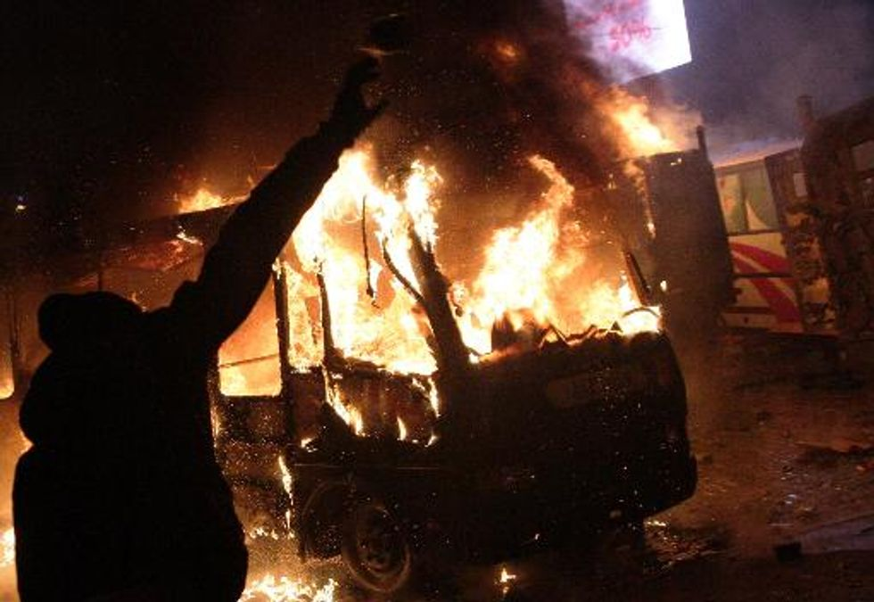 Protesters battle police, dozens wounded in bloody Ukraine clashes