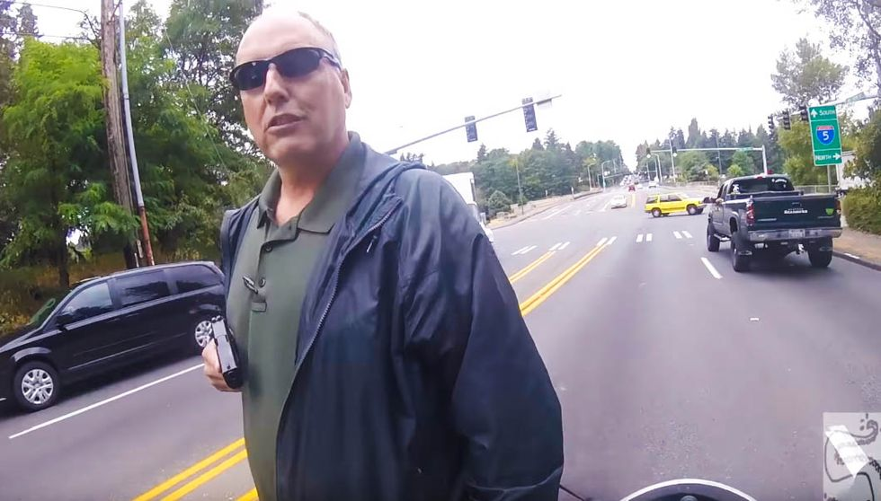 Terrifying video shows cop pulling gun on unarmed motorcyclist during routine traffic stop