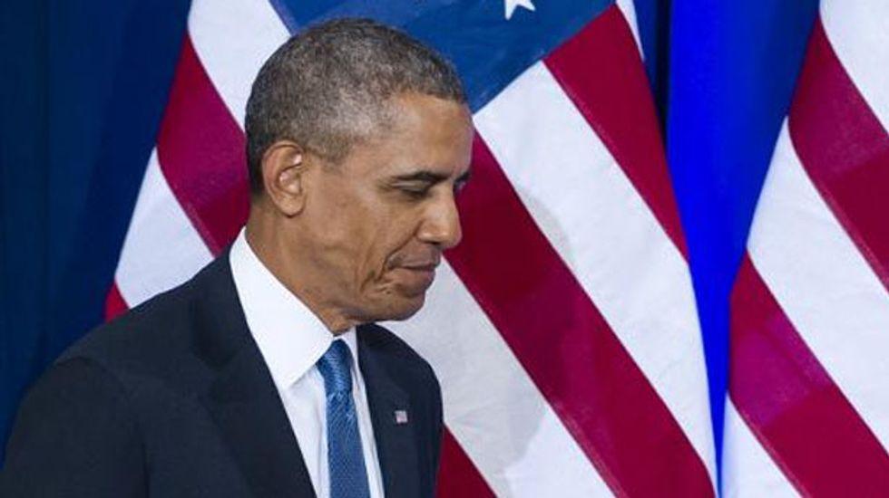 Family break over, Obama returns to Iraq nightmare