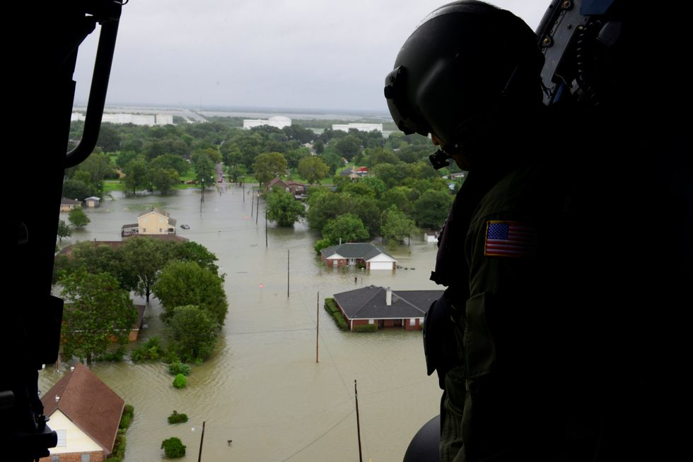 Harvey moves into Louisiana with at least 35 dead, 17 missing