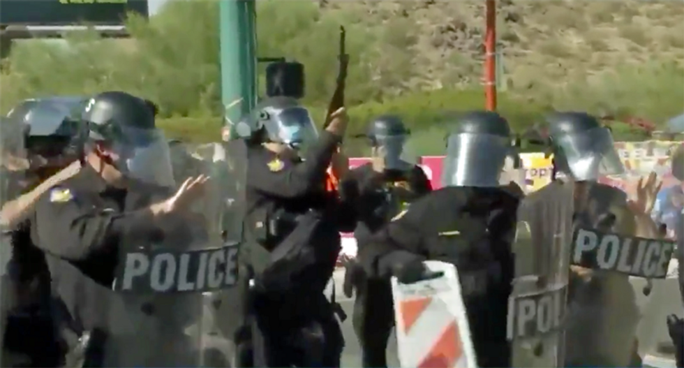 Police used pepper spray and flash-bang grenades on protesters outside Trump's controversial Phoenix rally: report