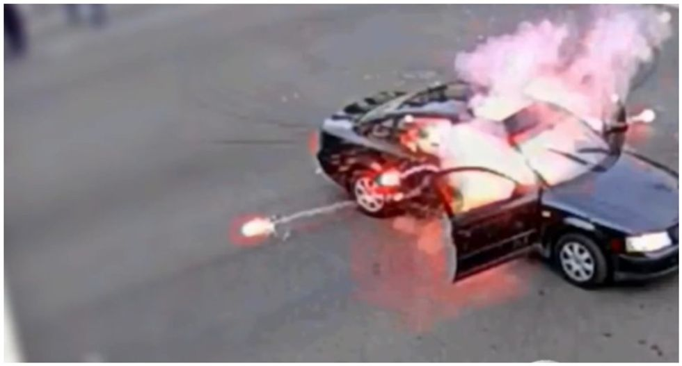 WATCH: Driver ignites firework at Black Lives Matter protest -- but protester tosses it back into his car