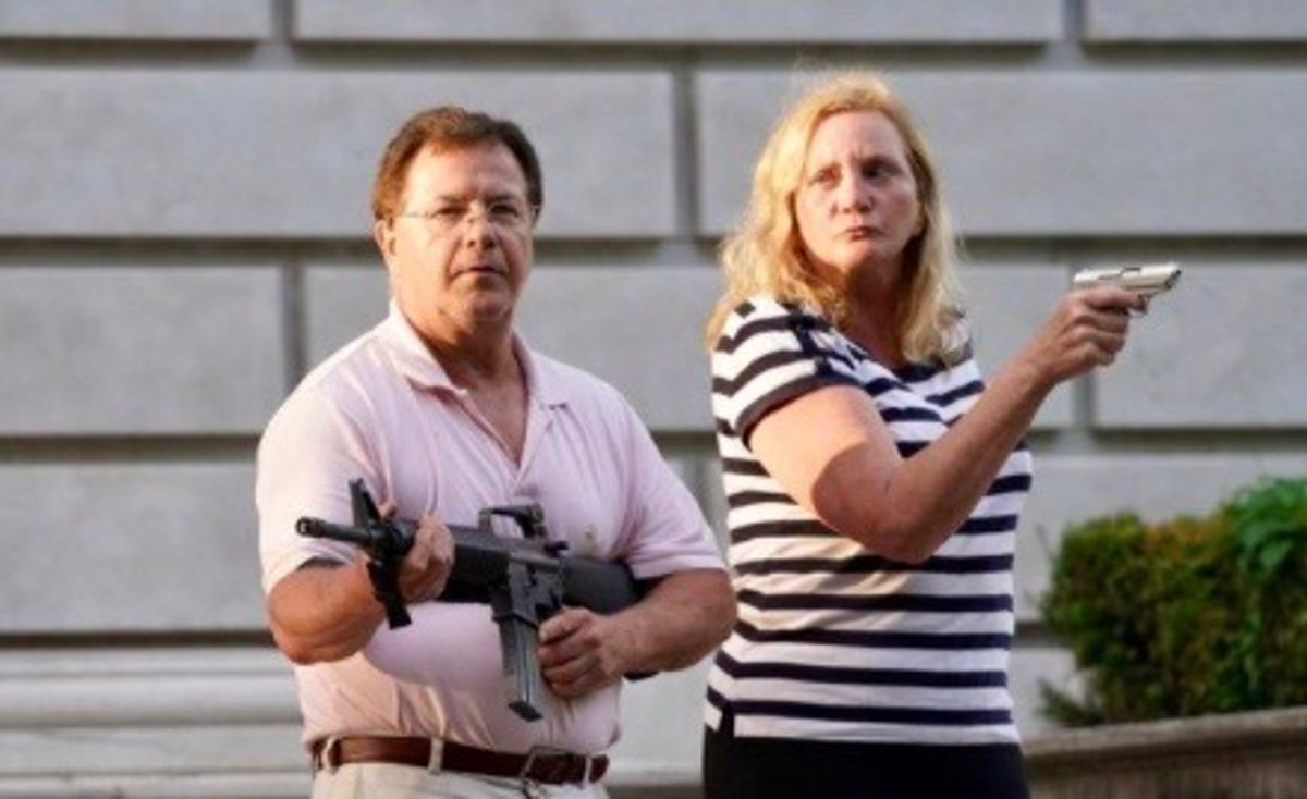 St Louis vigilante couple who aimed guns at protesters pleads guilty to misdemeanor assault