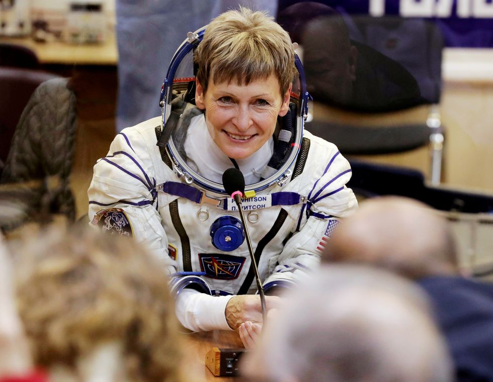 Record-breaking US astronaut and crew back on Earth