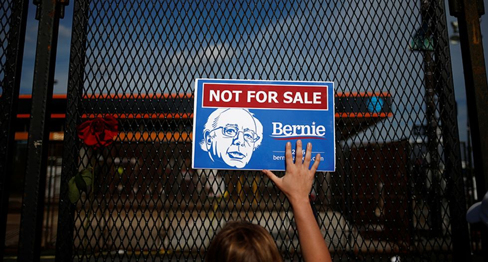 Among Democrats, another convention hums in Sanders fans' phones