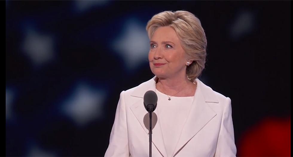 Clinton thinks regulators should scrutinize AT&T-Time Warner deal: spokesman