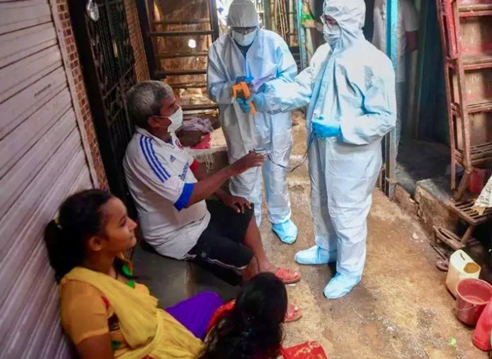 'Chasing the virus': How India's largest slum beat back a pandemic