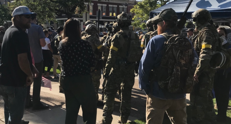 'They will not break our ranks': Armed camo-clad group moves in on Black Lives Matter protesters in Utah