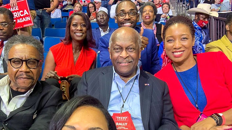Herman Cain admitted to hospital with COVID-19 after going mask-free at Trump's Tulsa rally