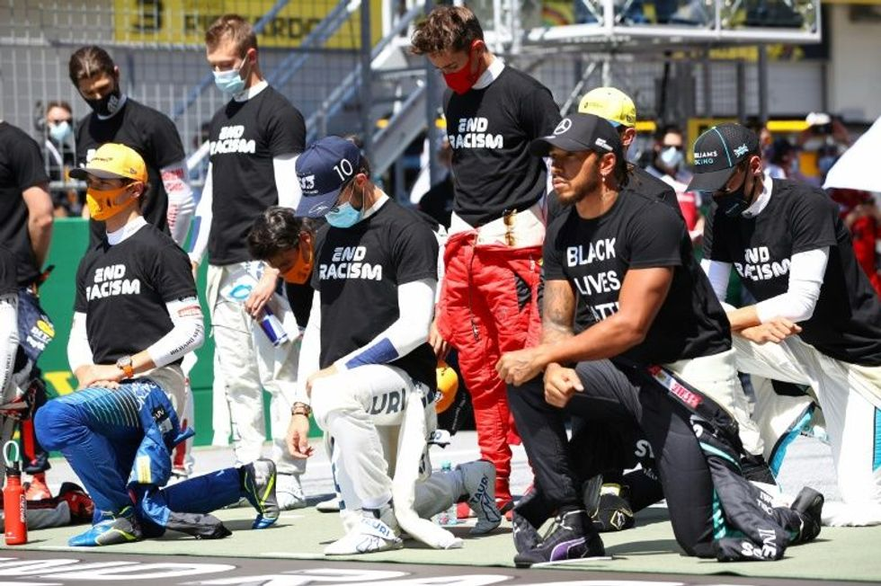 'It's about equality, not politics': Austrian Grand Prix driver Lewis Hamilton -- as six drivers refuse to take knee