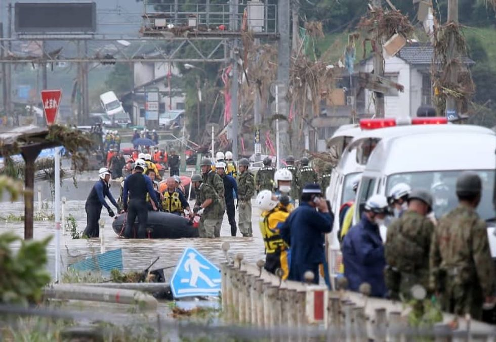 Dozens dead, missing in Japan as heavy rain causes floods, mudslides