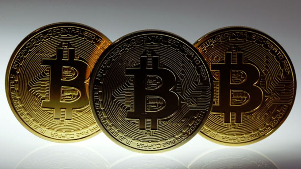 Bitcoin price plunges after 'Mt. Gox' marketplace indefinitely halts withdrawals