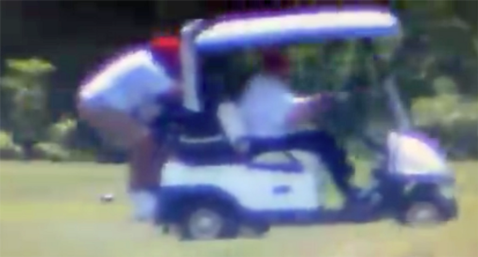 WATCH: Video shows how Trump makes his caddie hang on to the back of the golf cart