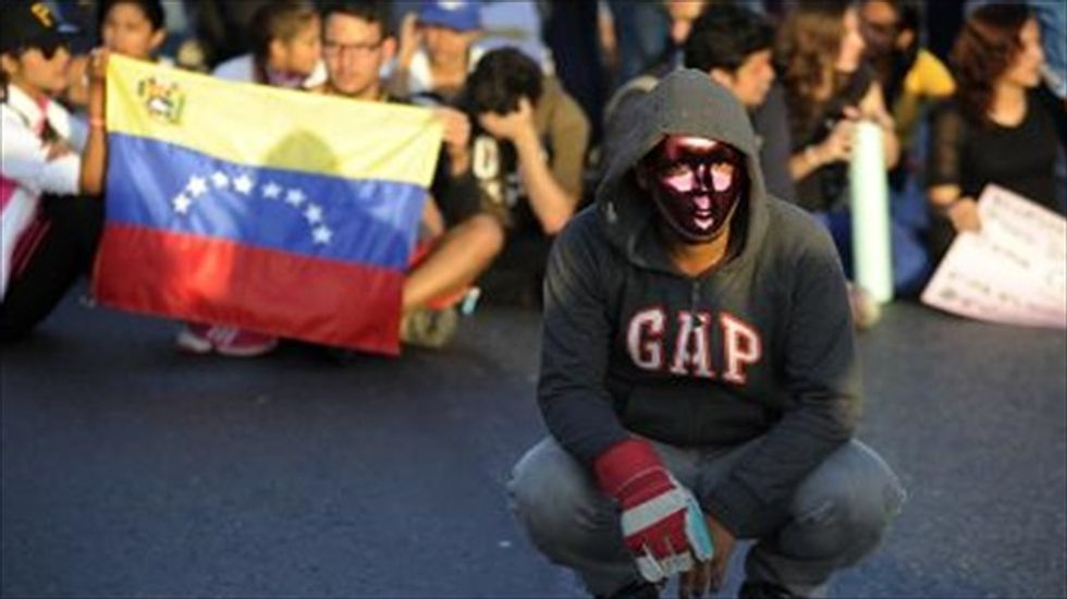 Students launch fresh protests in Venezuela as Maduro warns of coup attempt