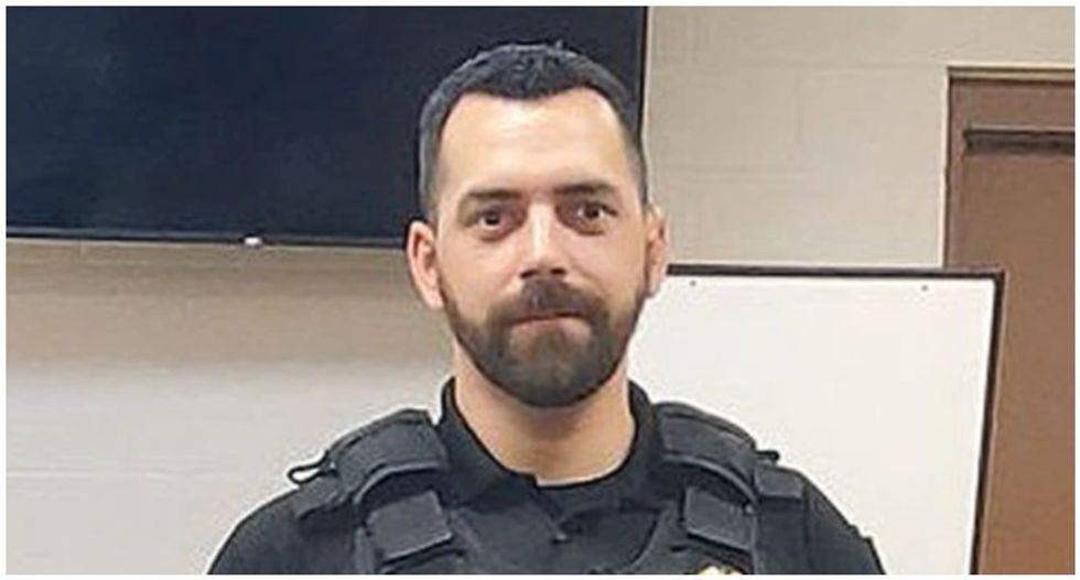 Cop threatened to shoot protesters if they came to his door -- now he's charged with killing a fellow officer who knocked