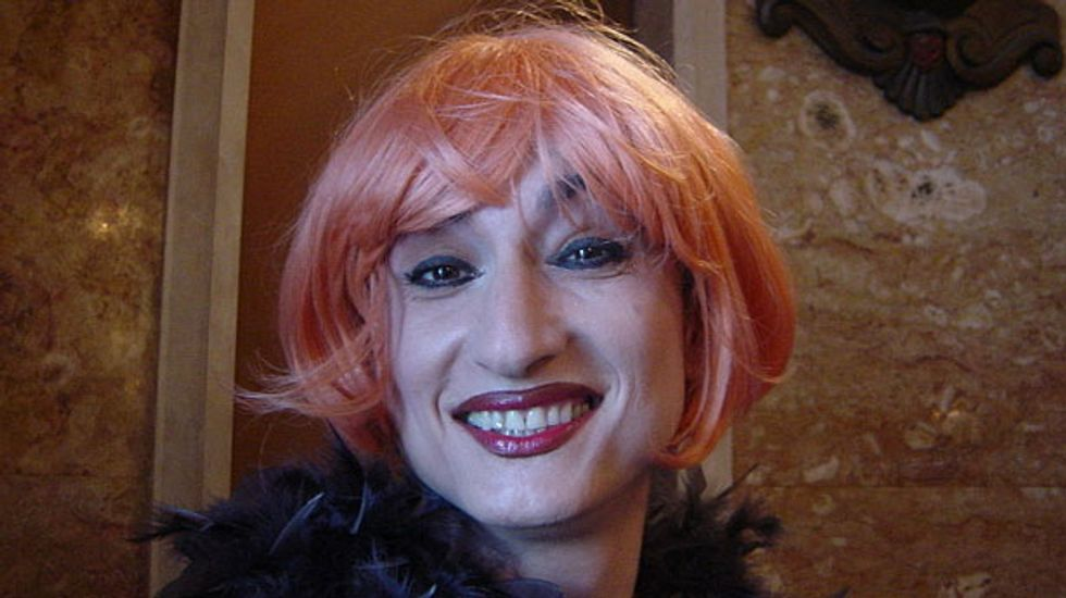 Europe's first openly transgender lawmaker arrested for holding 'Gay is OK' banner in Sochi