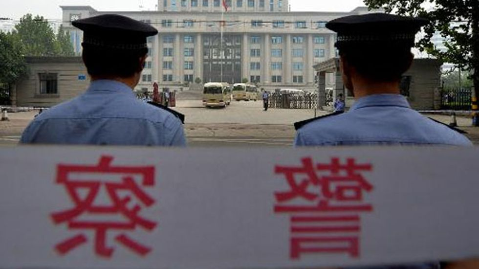 Chinese policeman sentenced to die for killing pregnant woman