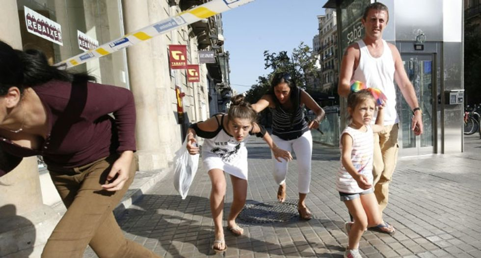 'People just started running screaming': Horror as van rams crowd in deadly Barcelona attack