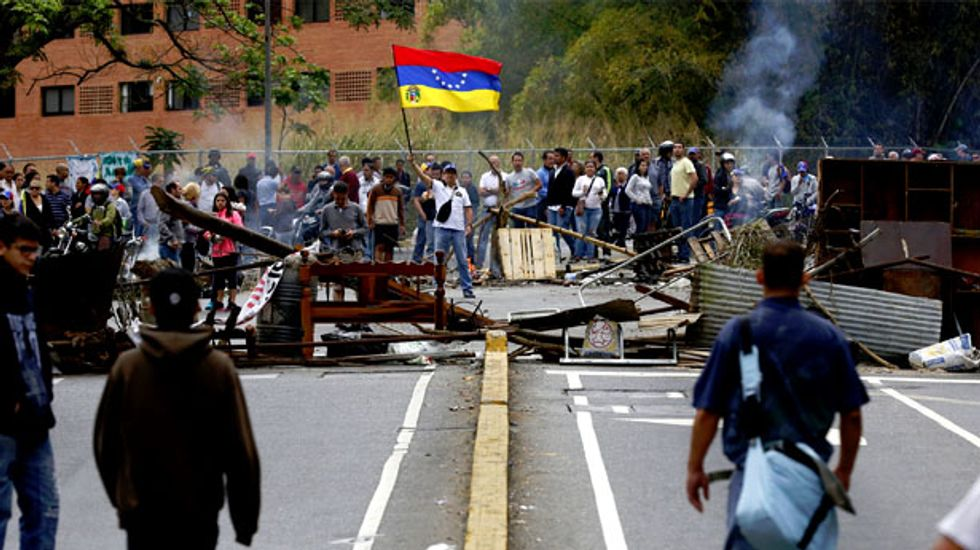 Violence in the streets as Venezuelan security forces clash with students