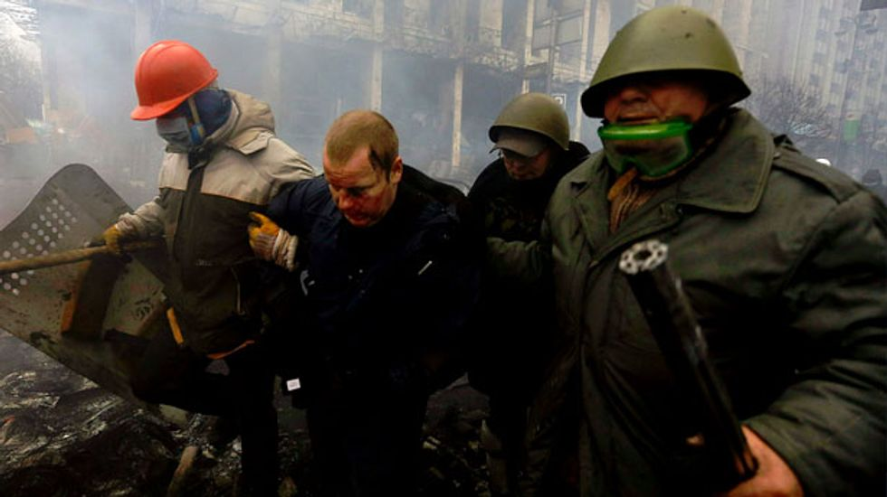 Bloodiest day since Soviet times: At least 67 killed in Kiev as riot police fire on protesters