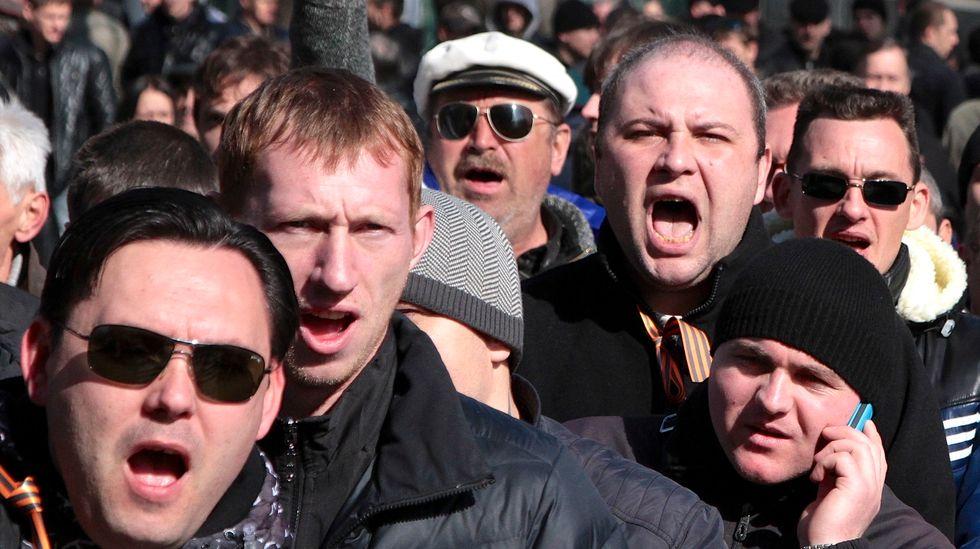 Ukraine parliament names acting president, seeks government