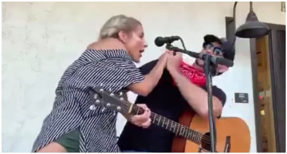 WATCH: Maskless woman gets in Texas musician's face over denied song request