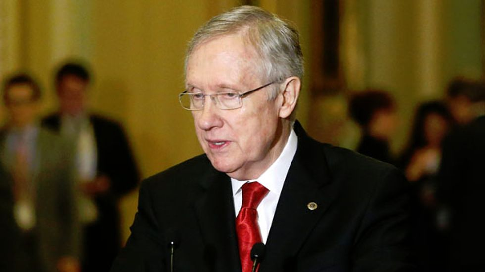 Harry Reid slams the Koch brothers for deceptive Obamacare 'horror stories'