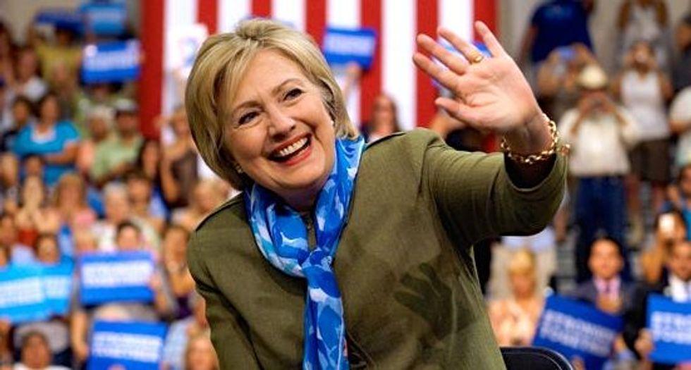 As Trump trips, Clinton seeks independents, Republican defectors