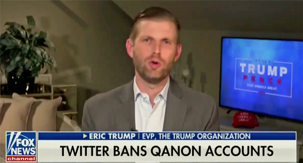 Fox News anchor praises QAnon conspiracy theorists for 'a lot of great stuff' during Eric Trump appearance