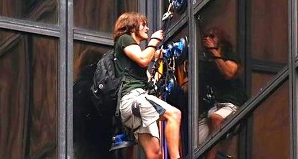 Man scales part of Trump Tower in New York City using suction cups