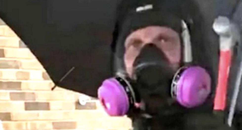 'Umbrella man' who sparked Minneapolis riots identified as racist biker gang member