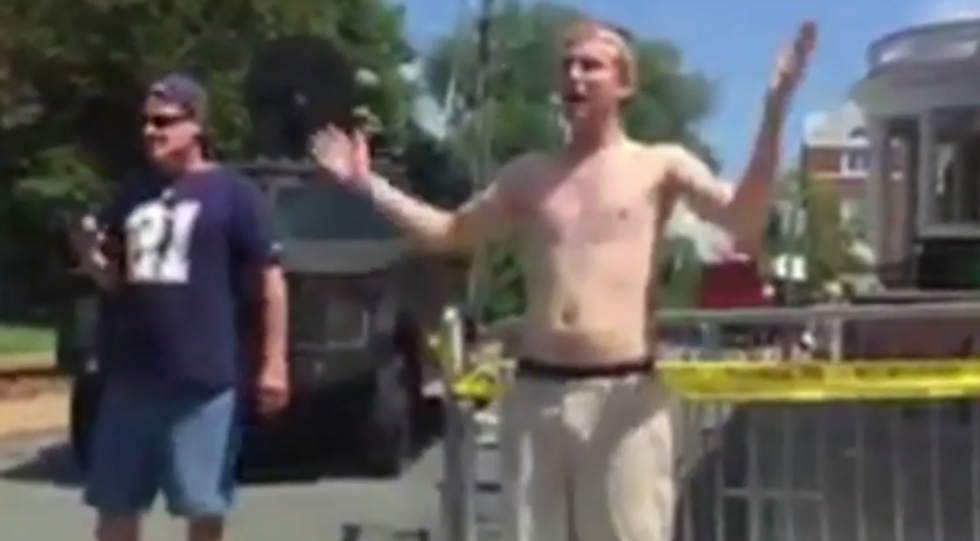 WATCH: Panicked white supremacist renounces beliefs the second he's confronted by masked demonstrator