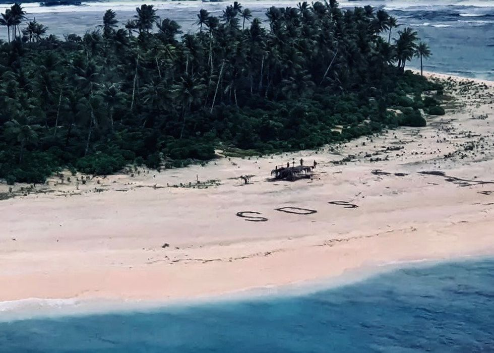 Stranded men rescued from Pacific island after writing SOS in sand