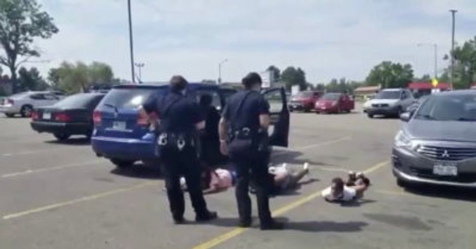 Cops handcuff 4 black children at gunpoint after pulling over wrong vehicle