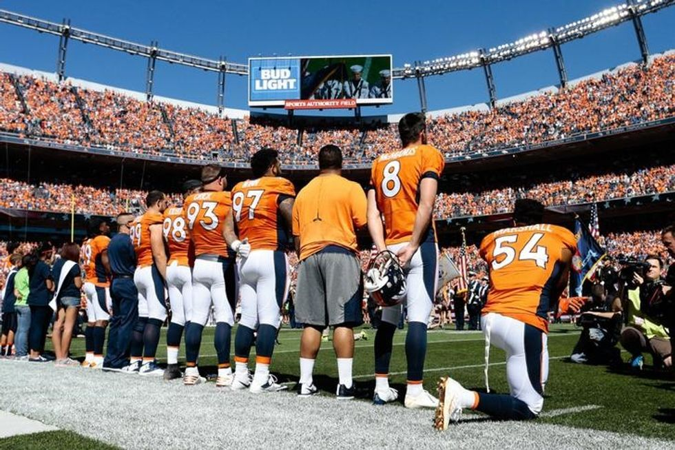 More kneeling players, raised fists, in anthem protests