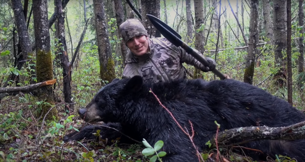 Hunter bro stabs a bear with a spear and leaves it -- then smiles and laughs about it dying in pain
