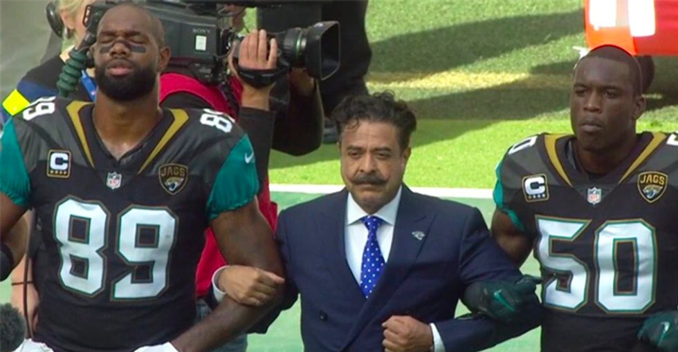 WATCH: NFL players, coaches and owner take knees and lock arms at London game in defiance of Trump