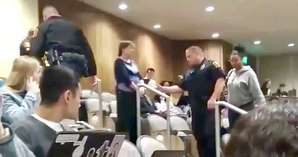White professor calls cops on black university student for putting her feet on chair during class
