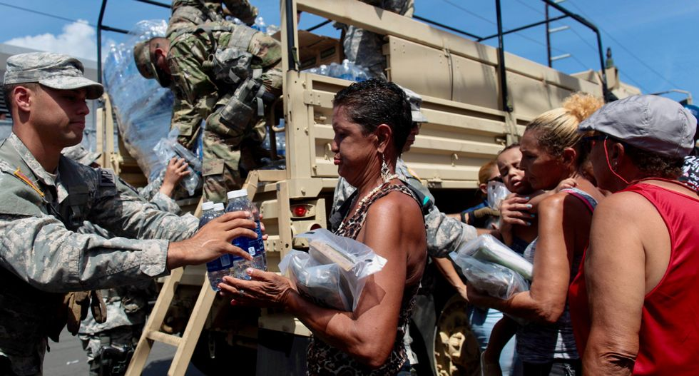 Travelers swamp Puerto Rico's main airport; dam on verge of collapse
