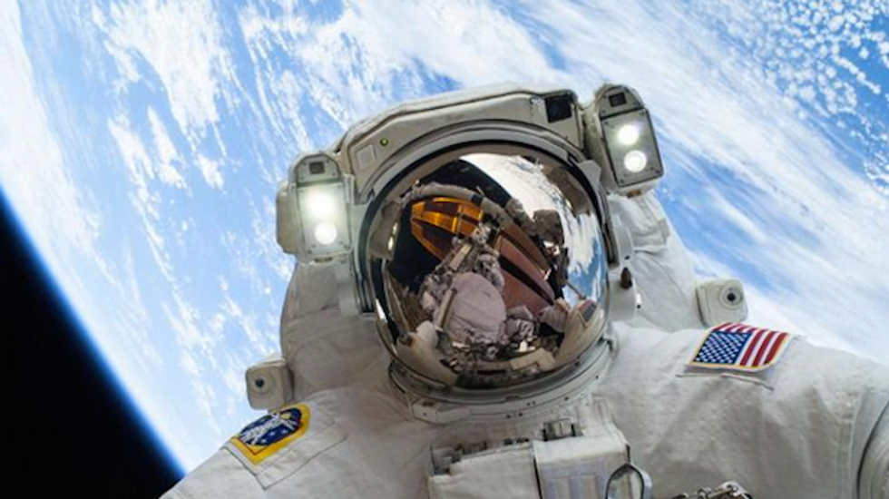 US astronauts spacewalk to prepare International Space Station for private space taxis