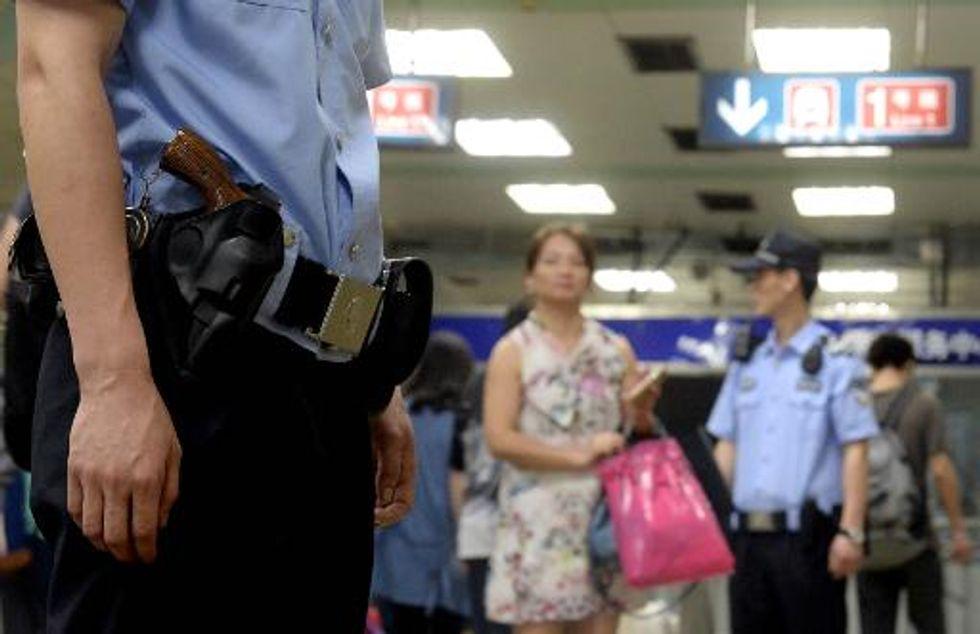 Gun safety demonstration wounds five at kindergarten celebrating China's International Children's Day