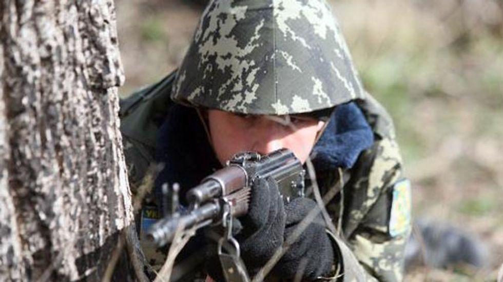 Ukraine parliament dismisses defense minister over Crimea crisis