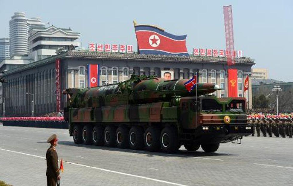 North Korea test-fires ballistic missiles as Obama hosts Japan-South Korea summit