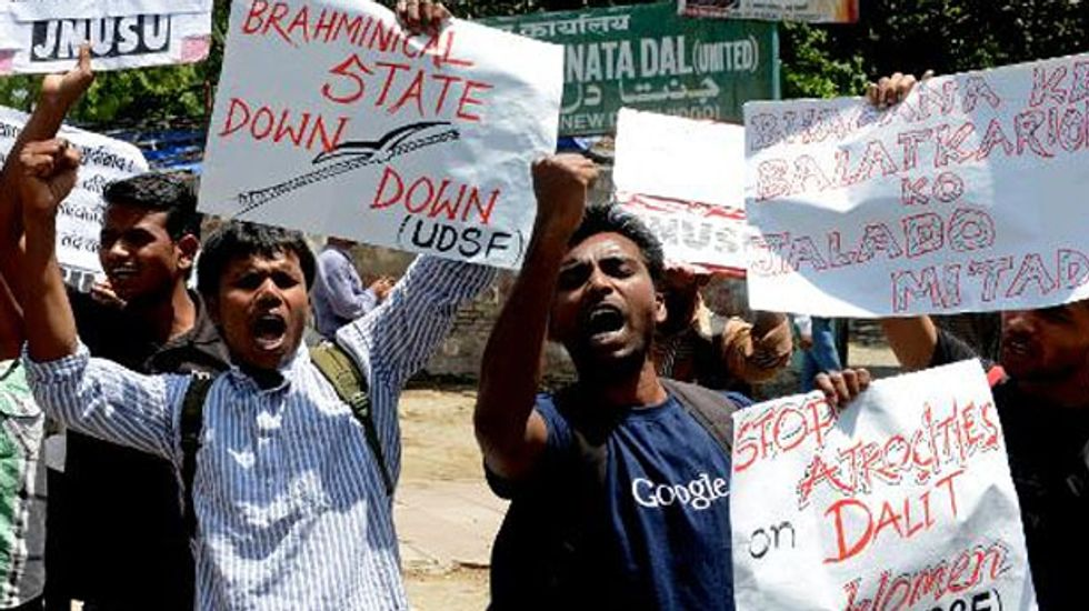Father of accused rapist arrested in India for viciously beating victim's mother