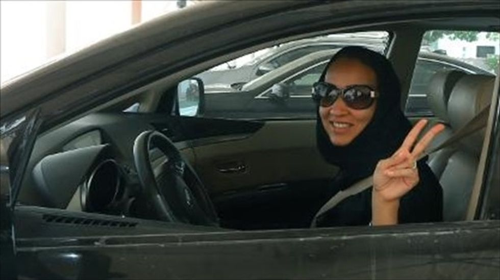 Saudi activists call for women to defy driving ban during Obama's visit