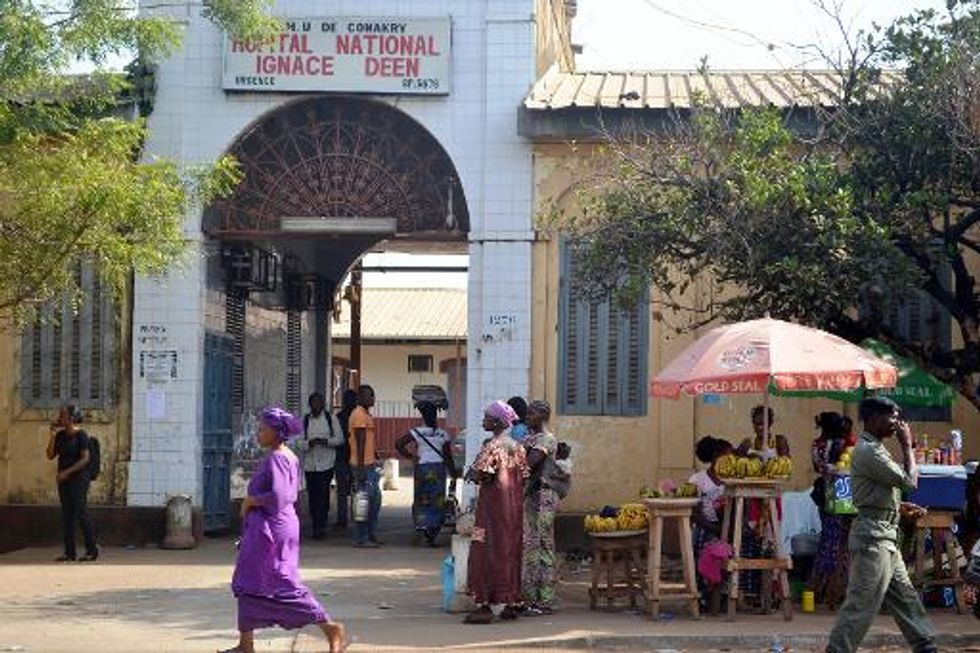 Guinea battles to contain deadly Ebola outbreak as Senegal closes its border