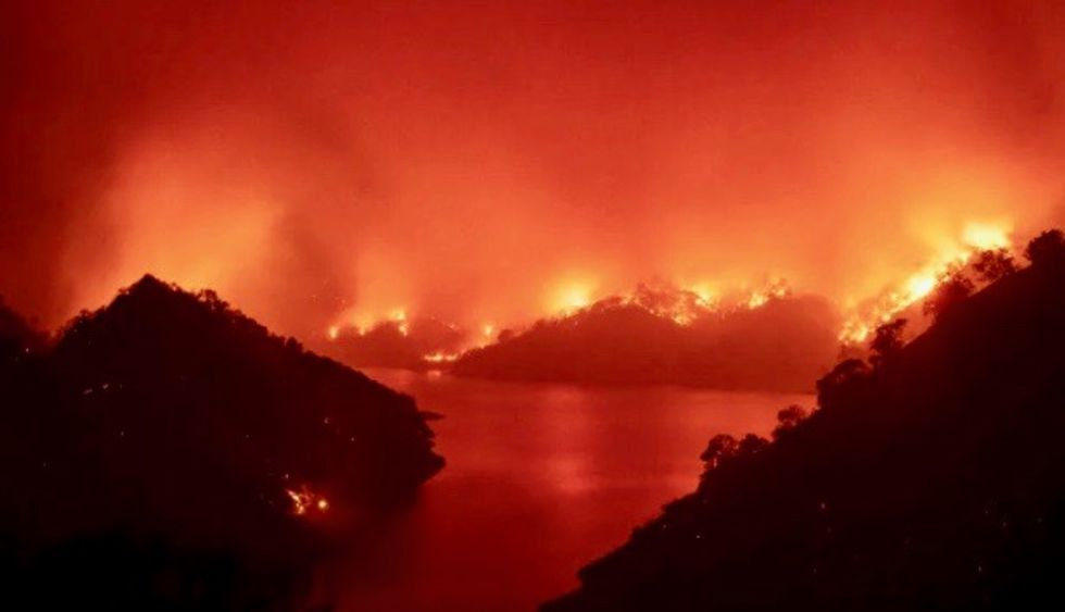 More evacuations as massive fires rapidly expand in California
